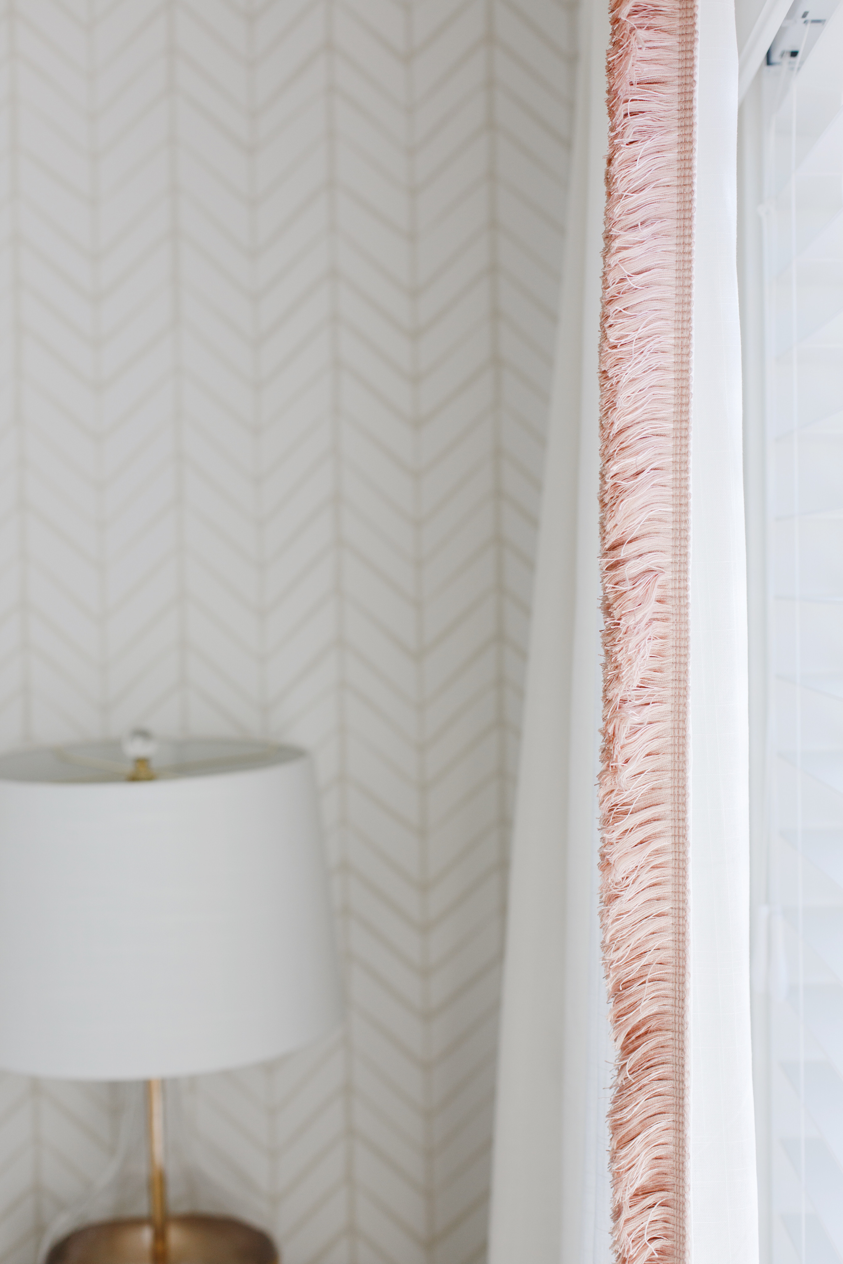 My mom sewed this adorable pink fringe on a set of IKEA curtains